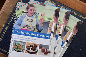 Step-By-Step Cookbook is an accessible cookbook by the Children's Trust