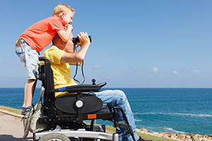 Father and son by the beach enjoying their Accessible Staycations in Norfolk
