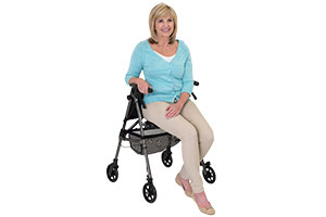 Woman sat on Able2 rollator