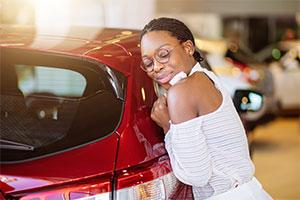 Motability scheme – a woman hugs new car
