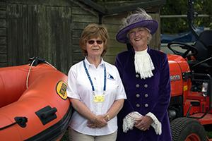 Women stood in front of boats at the Rutland Sailability