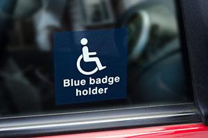 blue badge on side of car