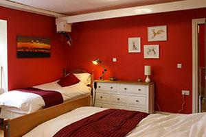 Red bedroom at the Moat House Inn